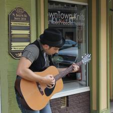 Guitar instructor John Sierra performs on Salem Street